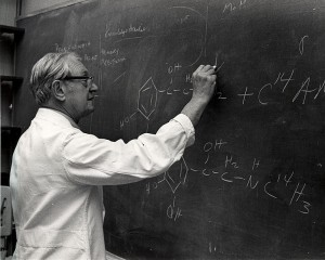 Dr. Julius Axelrod checking a student's work on the chemistry of catecholamine reactions in nerve cells.